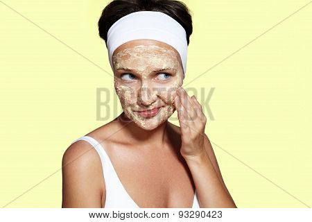 Woman Have Fun With A Facial Mask On A Yellow