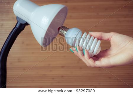 Installation Of A Modern Economical Bulb In A Table Lamp