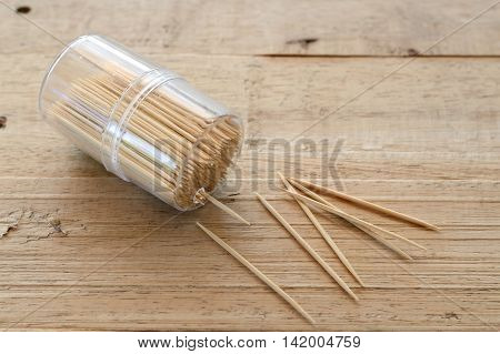 wooden toothpick in plastic box on wood table for cleaning teeth
