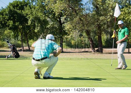 Golfer Reading The Green