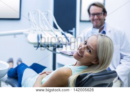 Portrait of female patient smiling in dental clinic