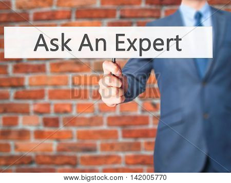 Ask An Expert - Business Man Showing Sign
