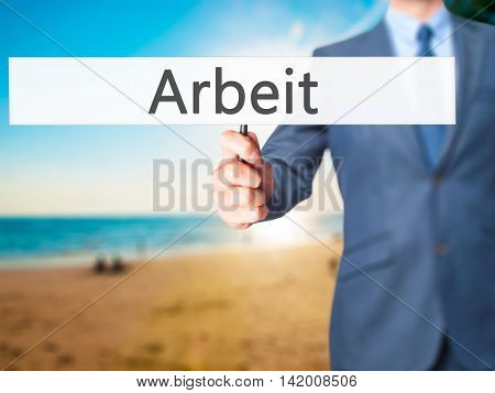 Arbeit (work In German) - Business Man Showing Sign