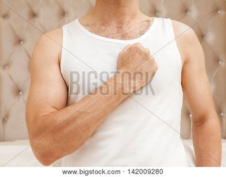 Young Sporty Man With Promise Gesture