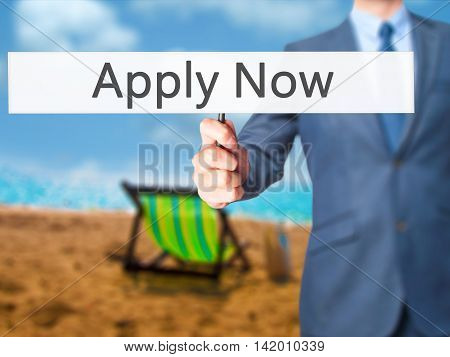 Apply Now - Business Man Showing Sign