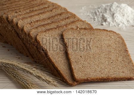 Thin slices of Brabants rye bread, flour and rye ears