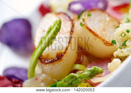 Scallop with pil pil jellyfish.
