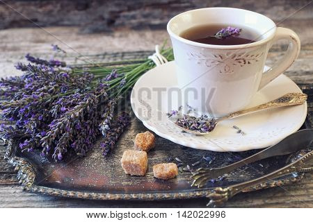 Аromatic lavender tea and bunch of lavender. Toned image