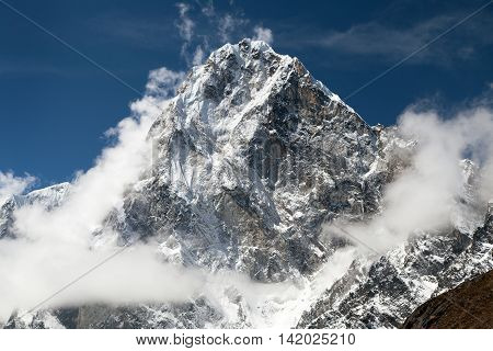 Mount Arakam Tse and clouds near Cho La Pass beautiful mount on the way to Everest base camp three passes trek Khumbu valley Sagarmatha national park Nepal