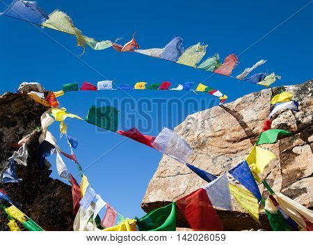 View of Prayer flags in himalayan pass Nepal