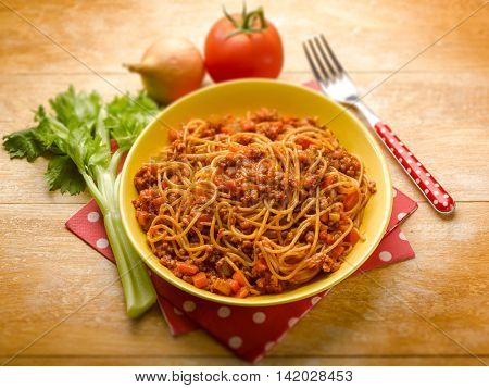 spaghetti bolognese with ragout sauce and parmesan cheese, selective focus