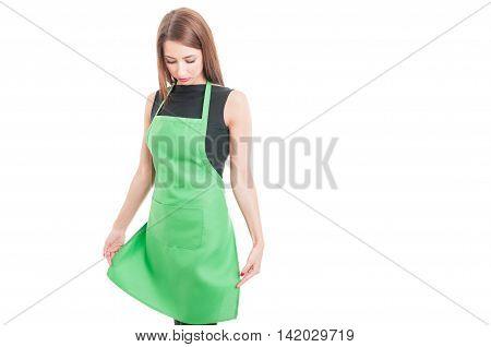 Beautiful Saleswoamn Arranging Her Green Apron