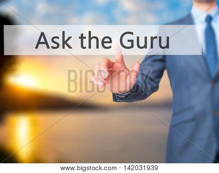 Ask The Guru -  Businessman Press On Digital Screen.