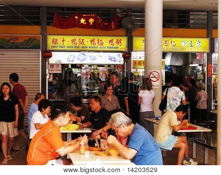 locals at a hawker food centre in Singapore