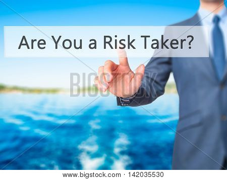 Are You A Risk Taker ? -  Businessman Press On Digital Screen.