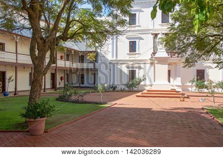 NEW NORCIA,WA,AUSTRALIA-JULY 15,2016: The Benedictine Monastery garden courtyard with statue in the historic monastic town of New Norcia, Western Australia.