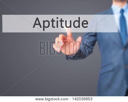 Aptitude -  Businessman Press On Digital Screen.