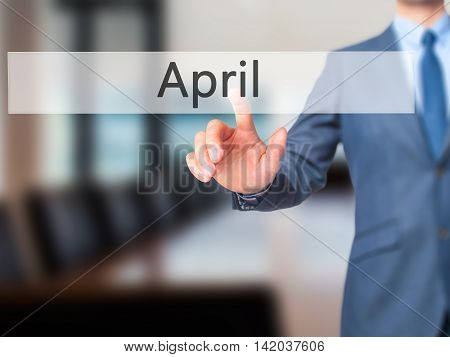 April -  Businessman Press On Digital Screen.