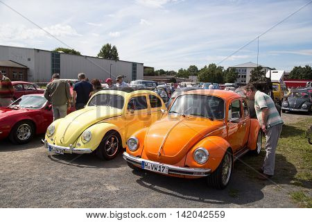 Celle, Germany - August 7, 2016: People and two Volkswagen Kaefer at the annual Kaefer Meeting