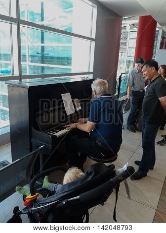 PRAGUE CZECH REPUBLIC - CIRCA JUNE 2016: public vertical piano at the Vaclav Havel airport in Prague