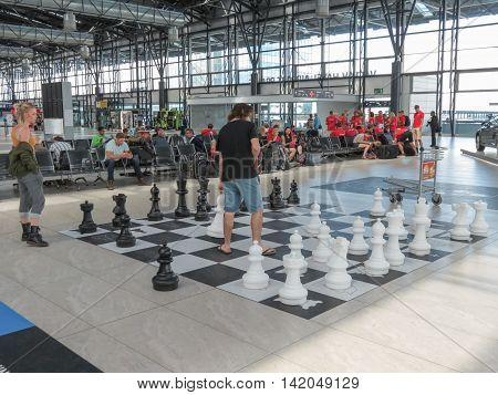PRAGUE CZECH REPUBLIC - CIRCA JULY 2016: couple playing chess on a floor chessboard at Vaclav Havel international airport