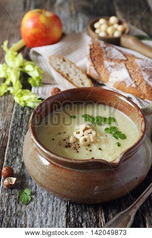 Dietetic apple celery cream soup with hazelnuts