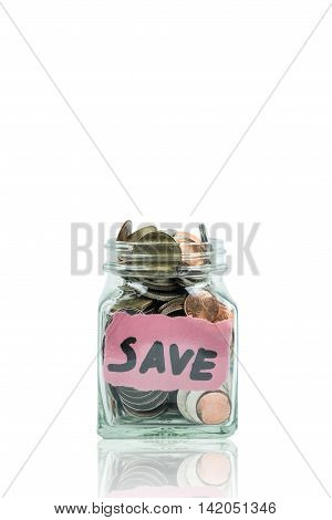 Glass jar of coin with save word isolated on white. Photo with clipping path