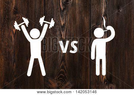 Paper man with dumbbells vs smoking. Abstract health conceptual image