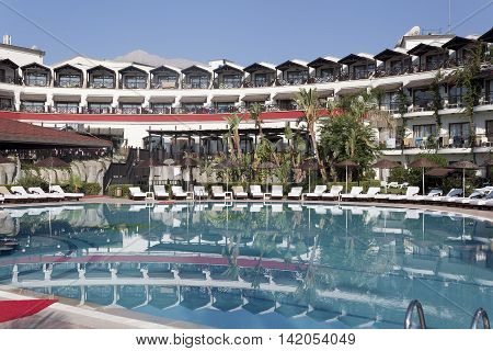 CAMYUVA KEMER TURKEY - JULY 15 2015: Labada Beach Hotel 5* (ex.Asdem Labada Hotel). In the pool there is no one in the early morning