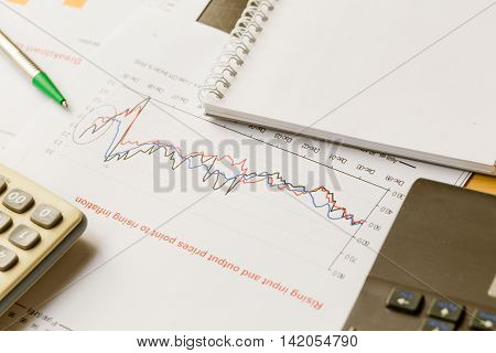 Business Working On Project With Laptop Calculator And Paper