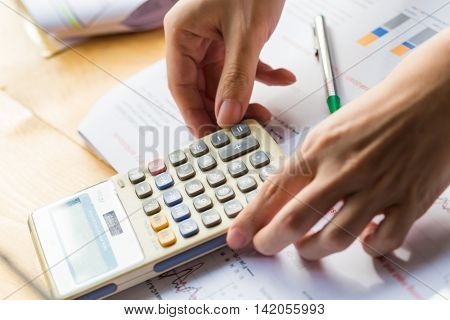 Hand Of Business Man Entrepreneur Calculating And Reviewing Investment Plan