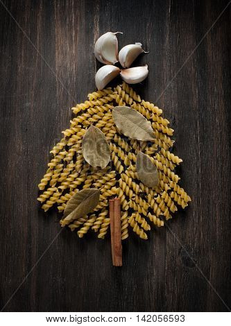 Christmas tree of pasta on the wooden background