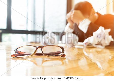 Depressed businessman ware suit in office Business and depressed concept soft focus vintage tone