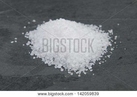 Pile of salt on a grey slate table stock picture