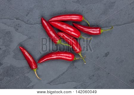 Red peppers on a grey cutting board stock picture