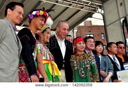 New York City - May 24 2015: N. Y. Senator Charles R. Schumer with performers and Taiwanese dignitaries at the annual Passport to Taiwan Festival in Union Square