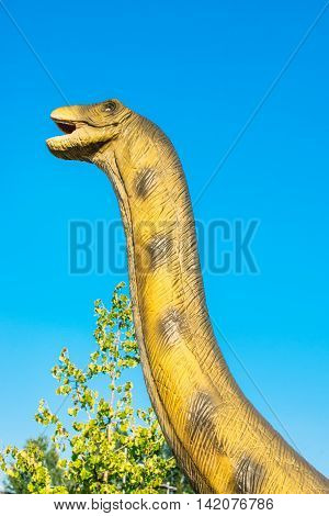 NOVI SAD SERBIA - AUGUST 5 2016: Brontosaurus life size model of prehistoric animal in theme entertainment Dino Park. Species of Brontosaurus range in age from 155 to 152 million years ago.
