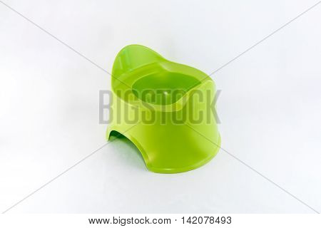 Isolated green toilet potty och white background.