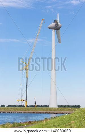 Construction site new Dutch windturbine with large crane