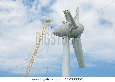 Assembling wings new Dutch windturbine with large crane