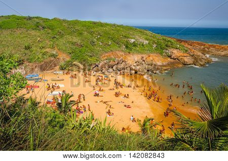 BARRA DO JACU ESPIRITO SANTO BRAZIL - DECEMBER 26 2015: Aerial Top View Large group of tourists sunbathing on the beach in sunny day