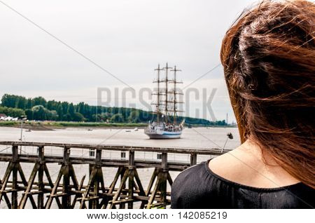 girl sees ship moving away further and further