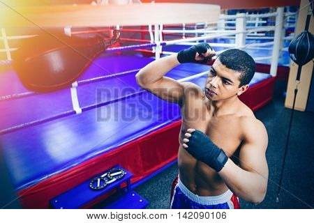 Male boxer exercising with the speed bag