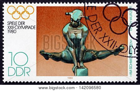 GERMANY - CIRCA 1980: a stamp printed in Germany shows On the Bars by Erich Wurzer 22nd Summer Olympic Games Moscow circa 1980