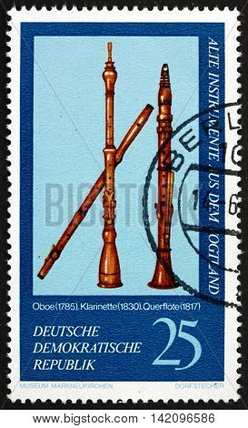 GERMANY - CIRCA 1977: a stamp printed in Germany shows Oboe 1785 Clarinet 1830 and Flute 1817 Vogtland Musical Instruments from Markneukirchen Museum circa 1977