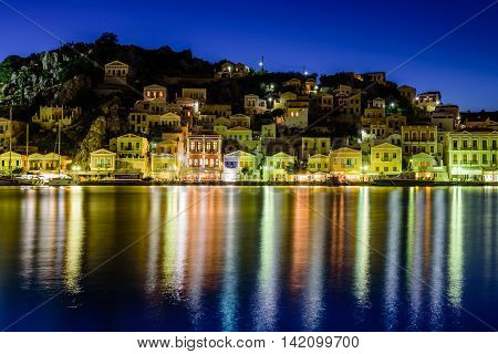 the scenic waterfront with colourful houses of Symi, night view, Symi island, Dodecanese, Greece.