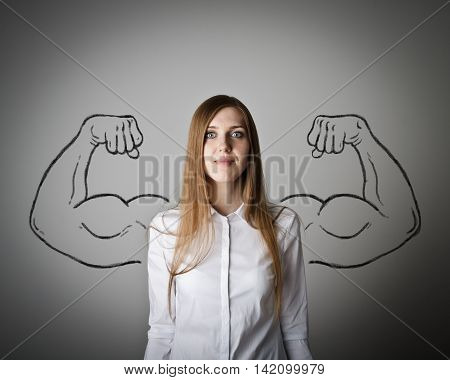 Woman in white with sketched strong and muscled arms.