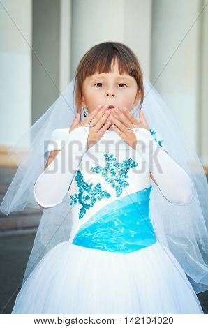 Air kiss little fashionista in the lush smart dress and Wedding Veil