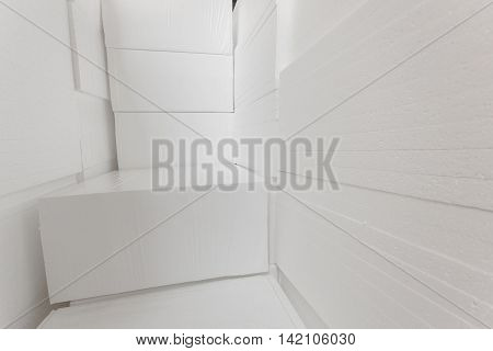 Polystyrene insulation boards. Polystyrene plates warehouse. Polystyrene Stack