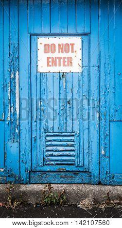 Grungy Rustic Blue Door iIth Do Not Enter Sign